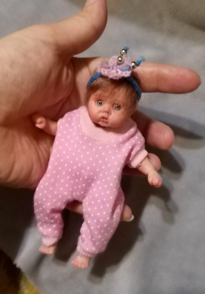 Silicone mini baby doll Nata 5 inch , painted, rooting hair, eyes open, open mouth with pacifier and bootle