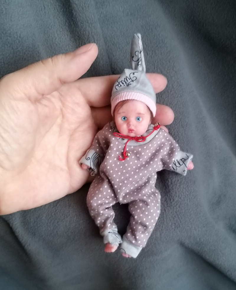 Minireborn  with pacifier and bootle, original clothes