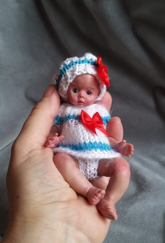 Miniature silicone girl in a marine suit knitted handmade02