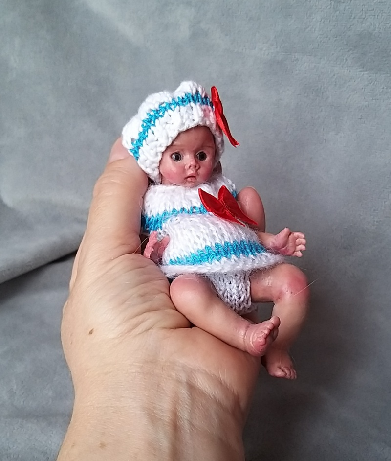 Miniature silicone girl in a marine suit knitted handmade03