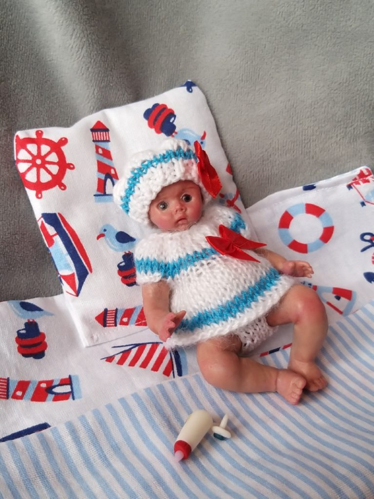 Miniature silicone girl in a marine suit knitted handmade12