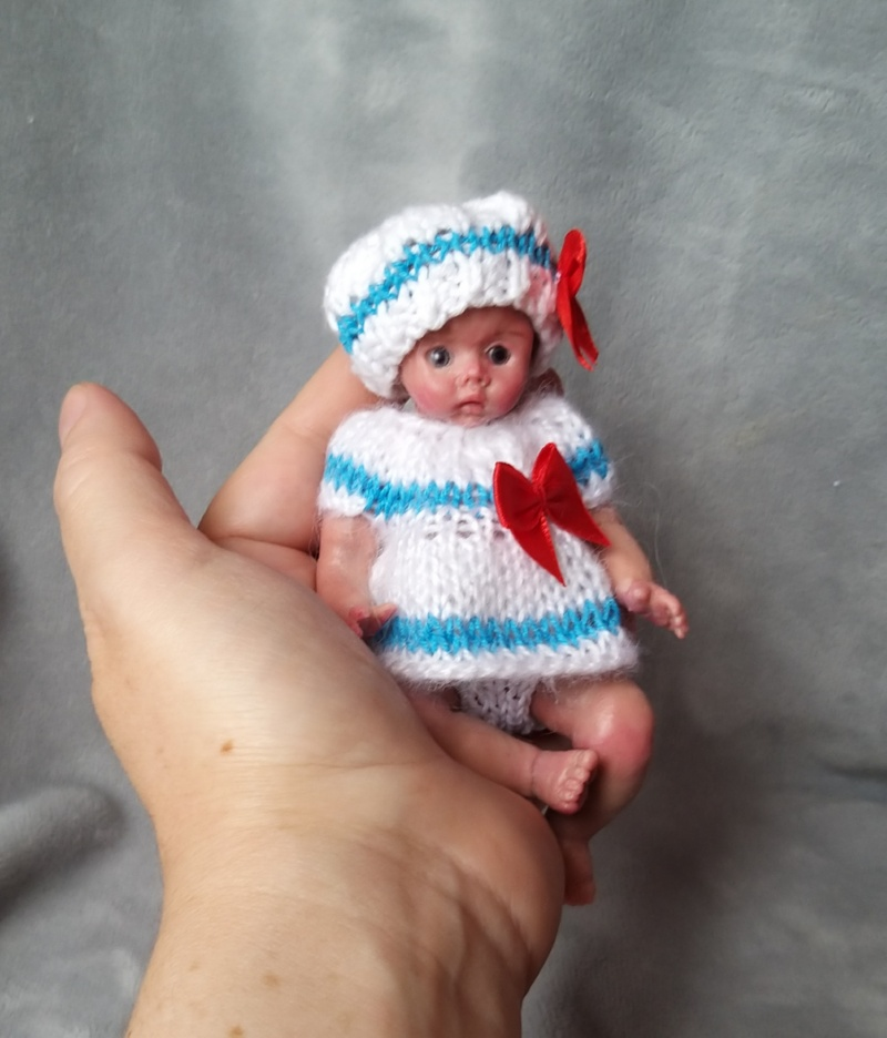 Miniature silicone girl in a marine suit knitted handmade13
