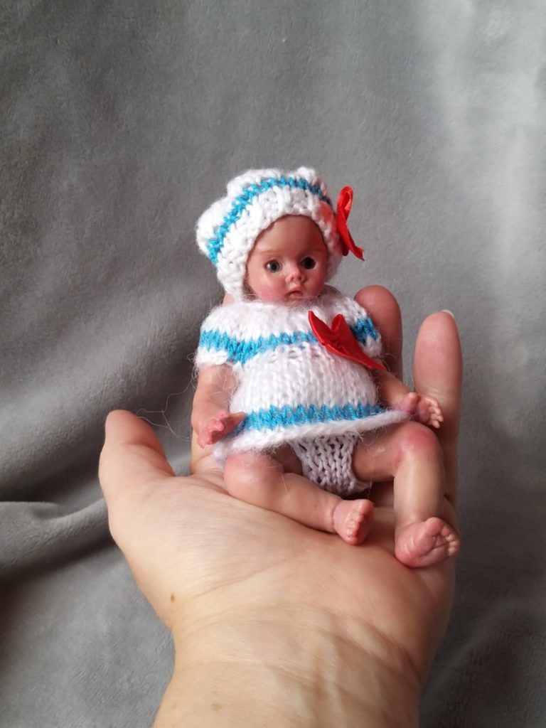 Miniature silicone girl in a marine suit knitted handmade14