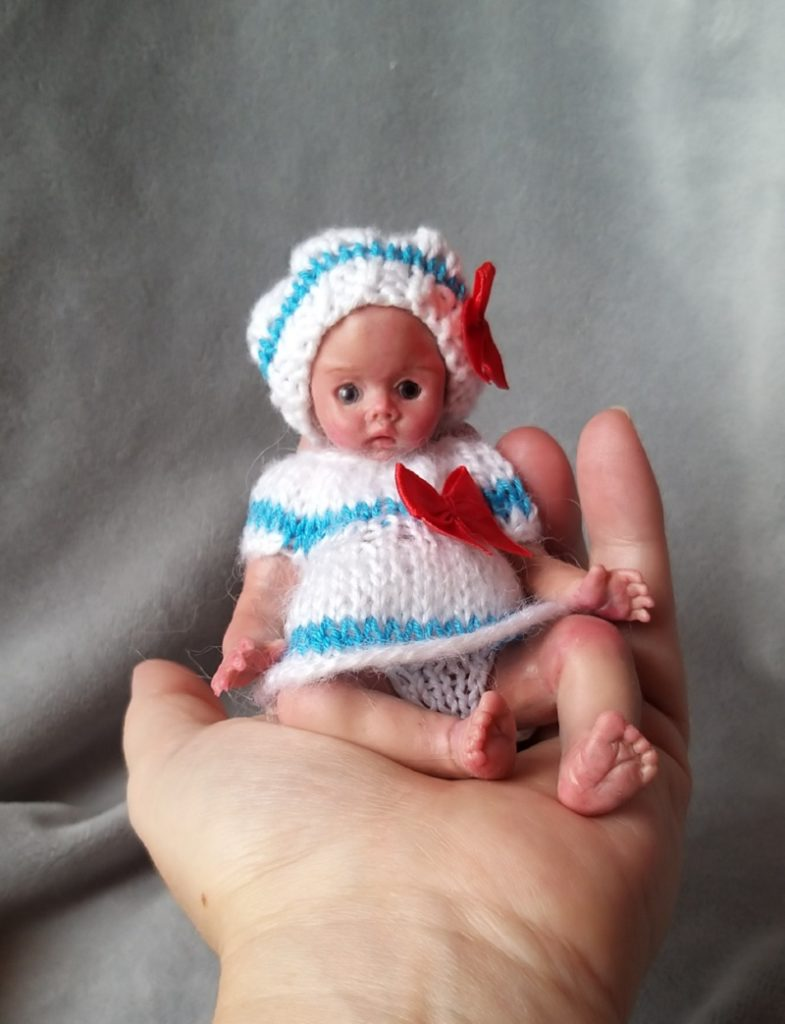 Miniature silicone girl in a marine suit knitted handmade15