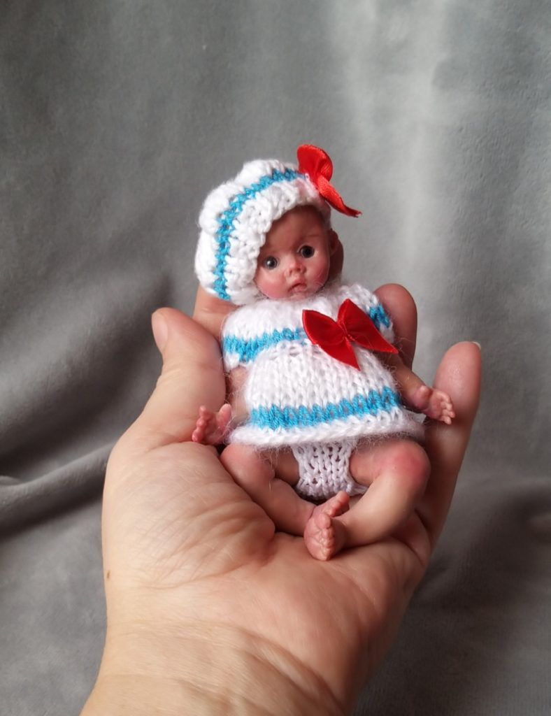 Miniature silicone girl in a marine suit knitted handmade16