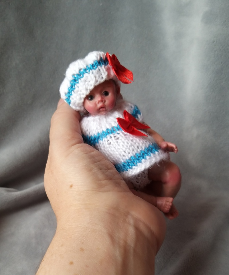 Miniature silicone girl in a marine suit knitted handmade17