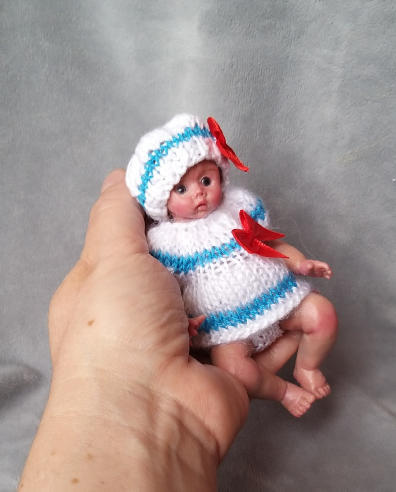 Miniature silicone girl in a marine suit knitted handmade18