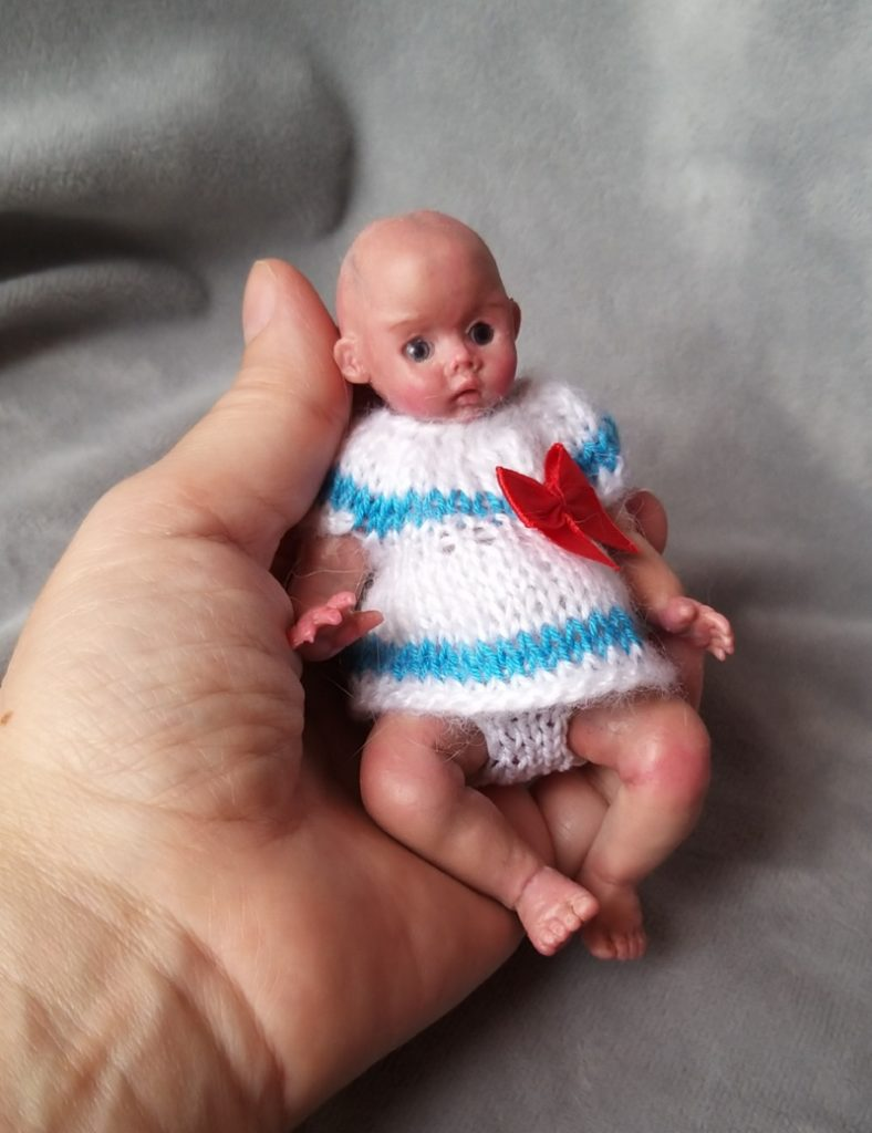 Miniature silicone girl in a marine suit knitted handmade19